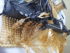 Weaving with black gold and white curling ribbon